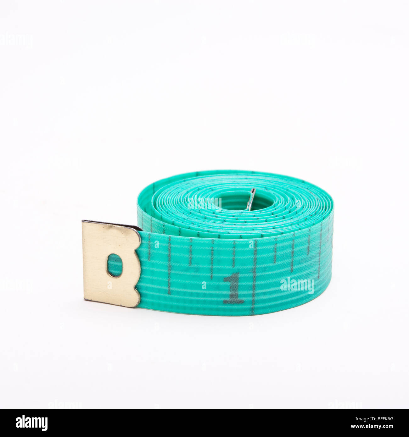 Dressmakers or Tailors rolled up tape measure isolated against white background. Stock Photo