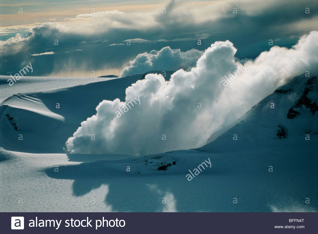 Volcanic steam in snowfield on summit of Mt. Wrangell (aerial), Wrangell St. Elias National Park, Alaska - Stock Image