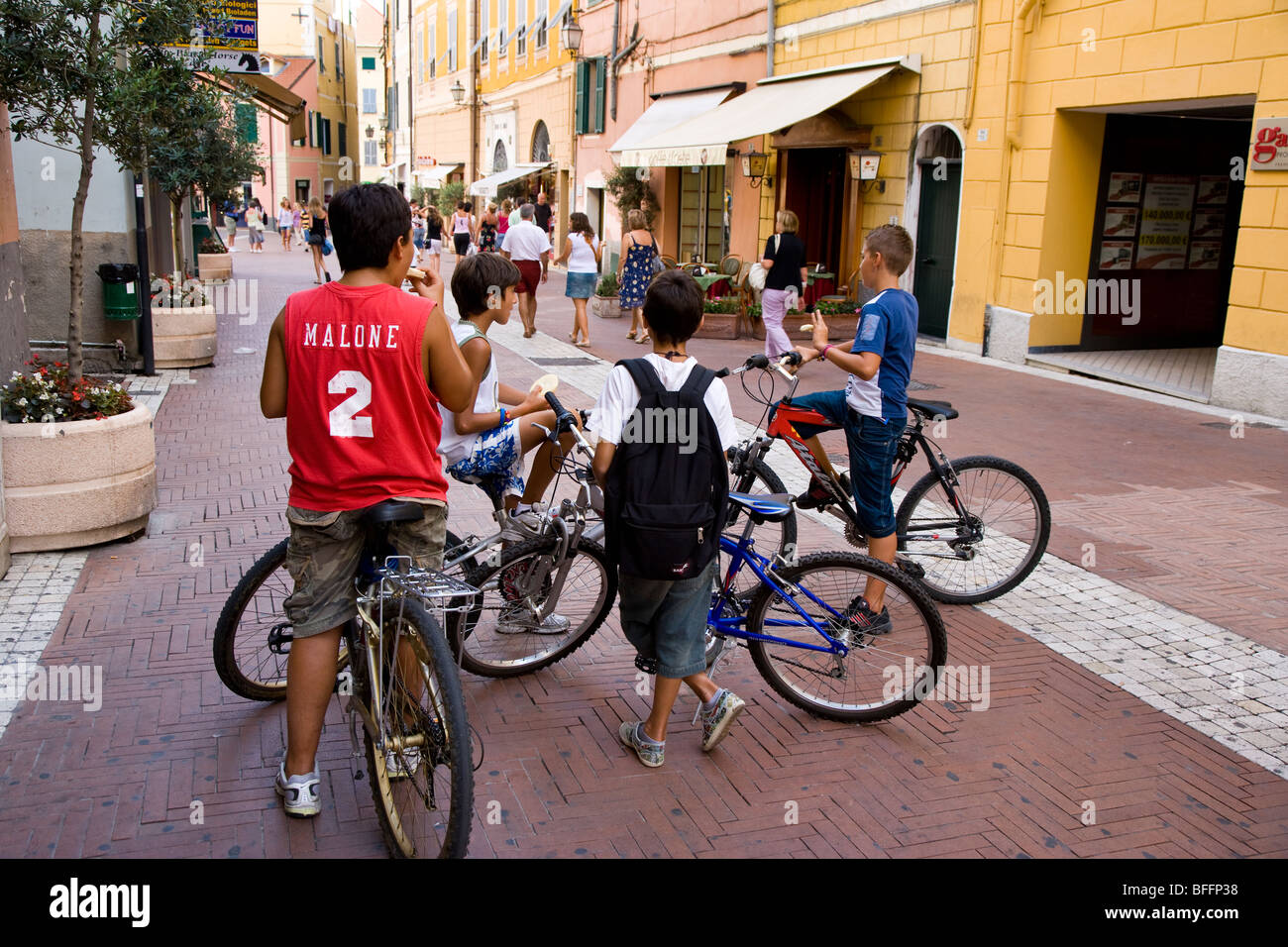 children on bicycles, Imperia Italy - Stock Image
