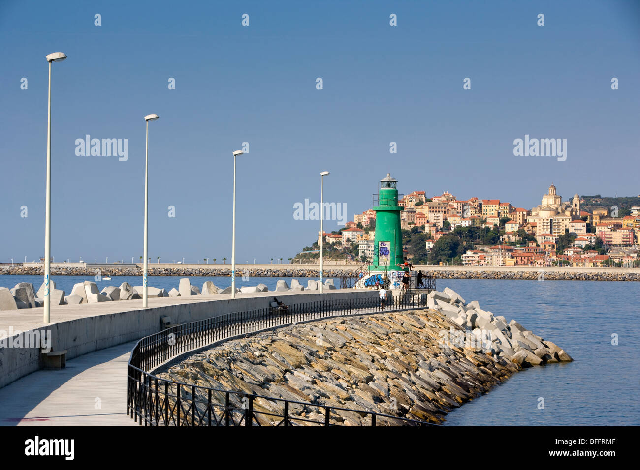 Green lighthouse with Imperia, liguria, Italy - Stock Image