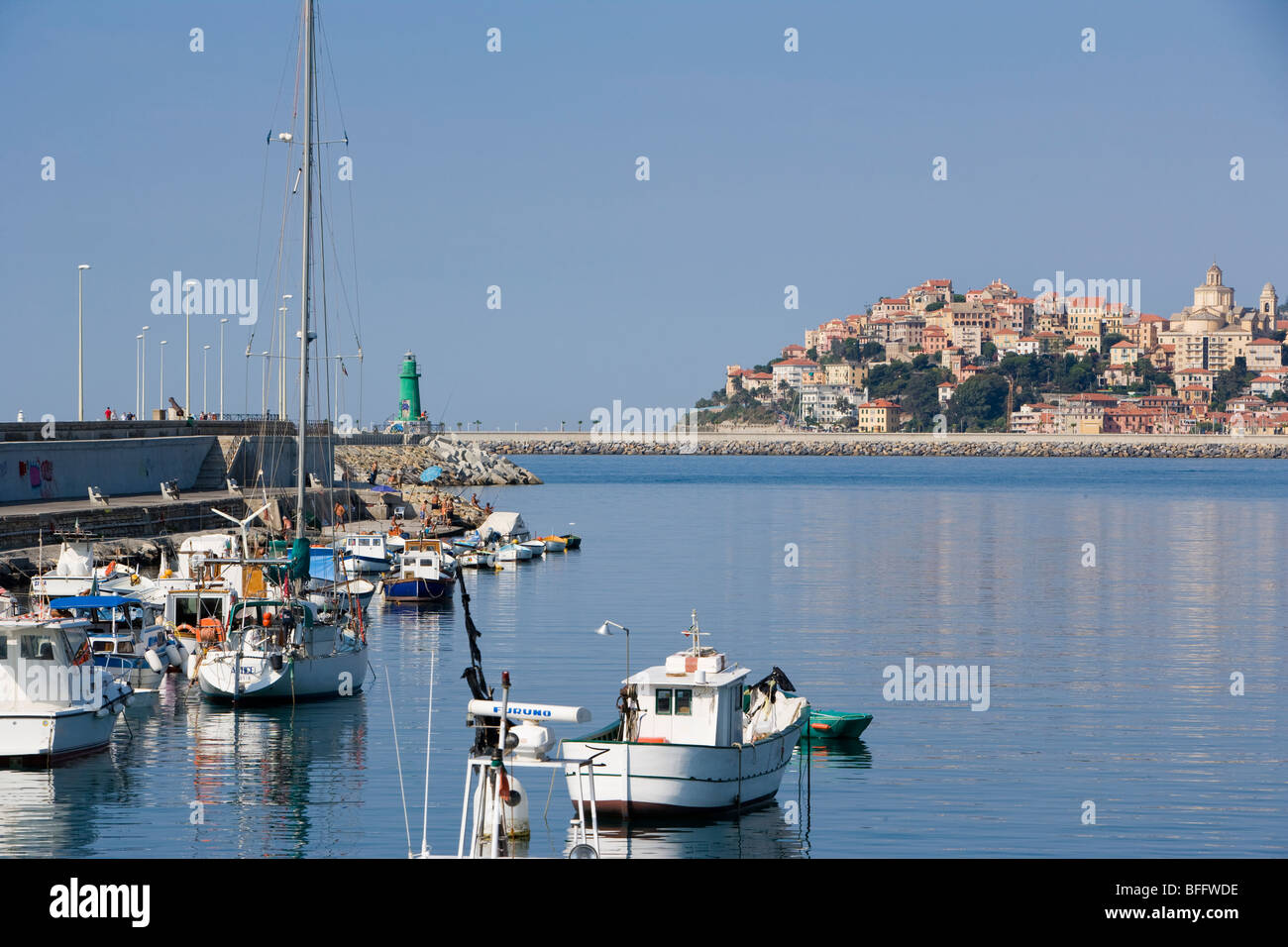 Harbour and boats with Imperia in the background, liguria, Italy - Stock Image