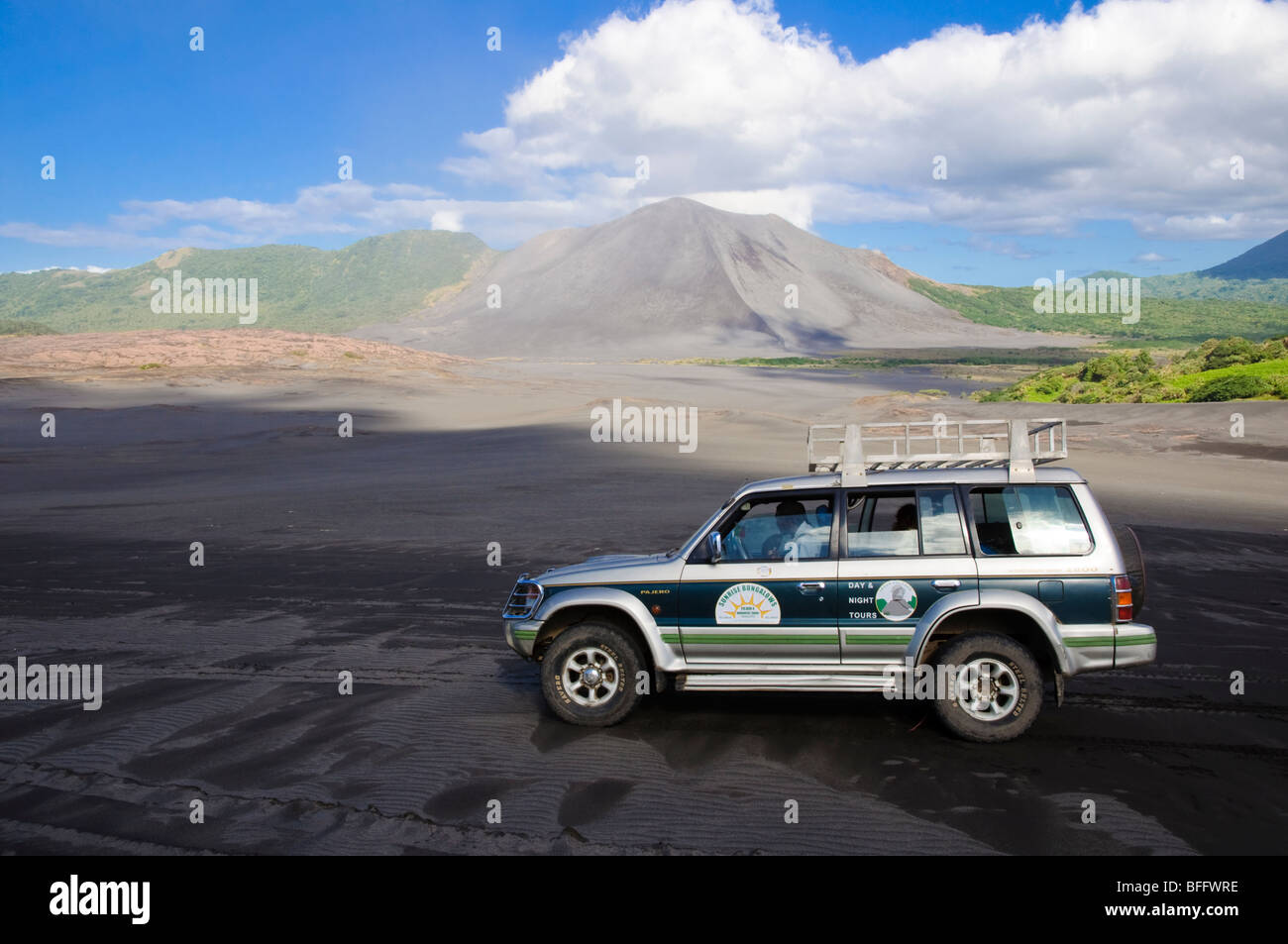 4WD vehicle in front of an active volcano. Click for details. Stock Photo