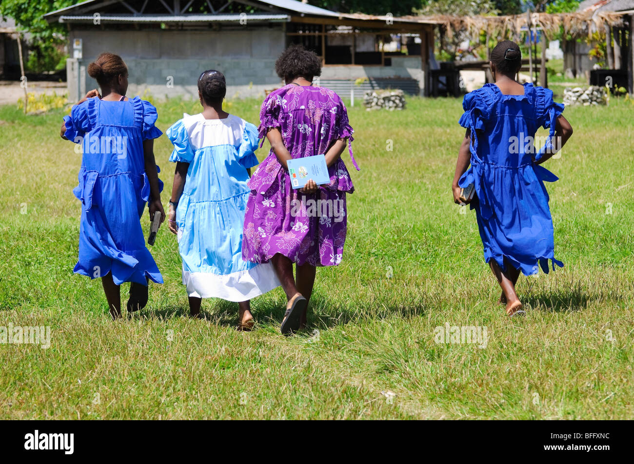 Melanesian ladies in their Sunday best, returning home from church. Click for details. - Stock Image