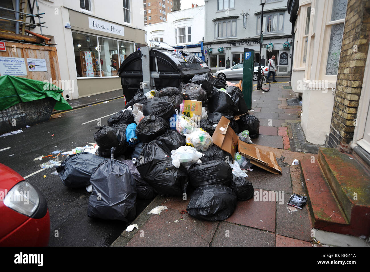Overflowing communal bins in brighton after a strike by refuse workers about pay - Stock Image