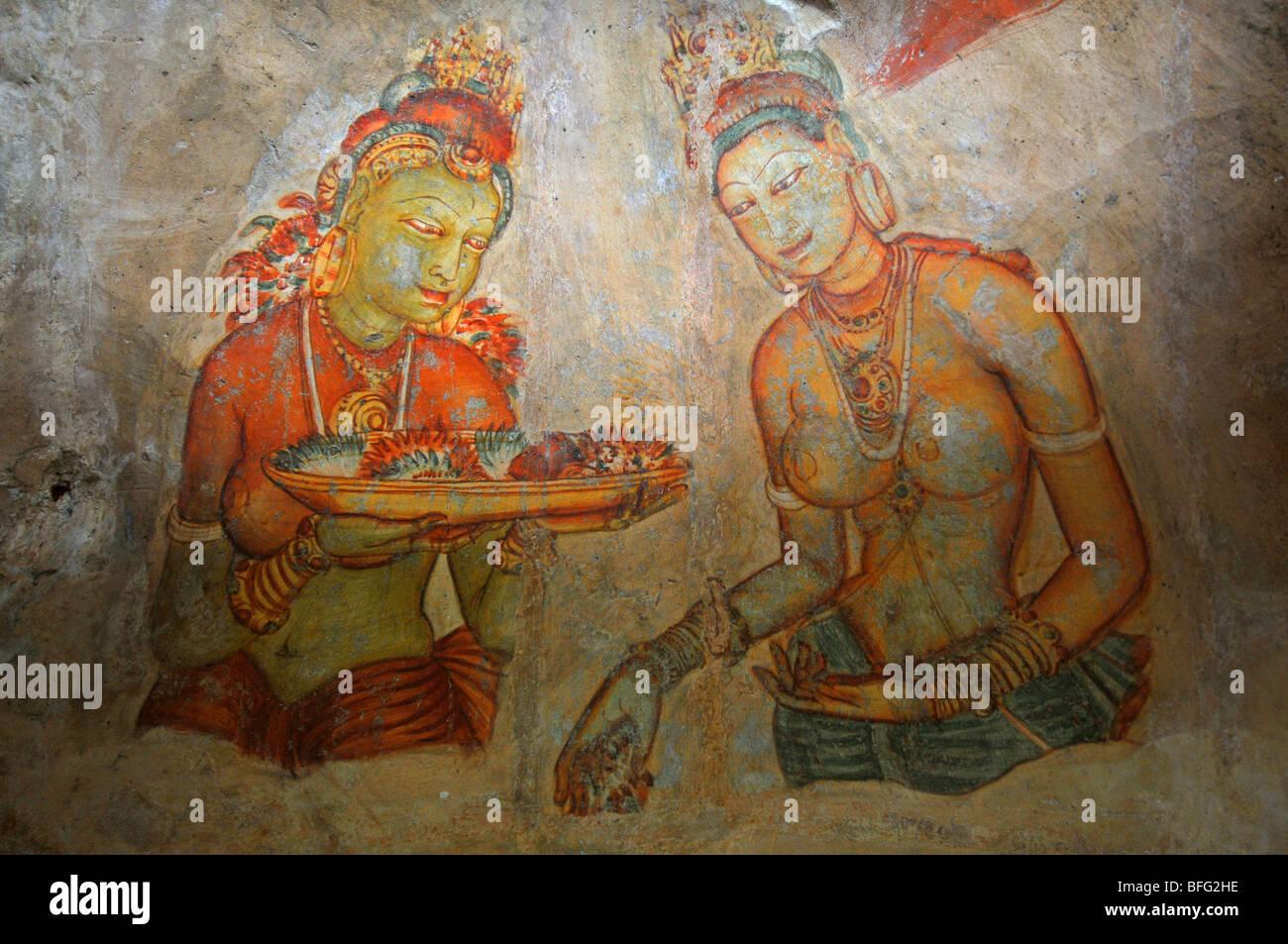 Sigriya wall paintings, Sri Lanka, mural of Asparas or female spirits at Sigriya Rock Fortress, Sri Lanka - Stock Image