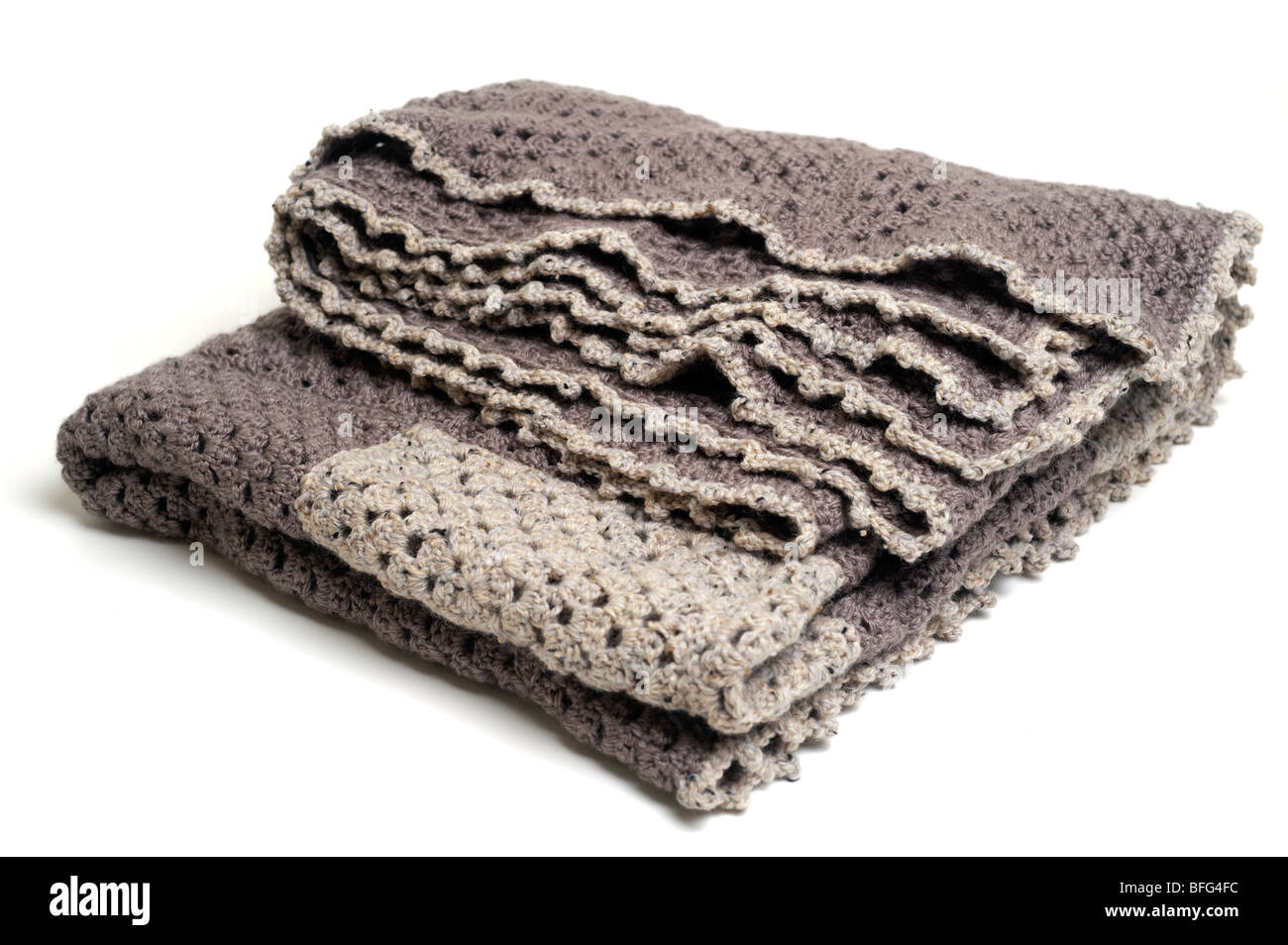 Brown and beige coloured crocheted blanket - Stock Image