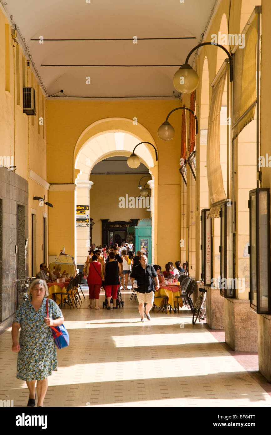 Shopping arcade with pavement cafe, Imperia, liguria, Italy - Stock Image