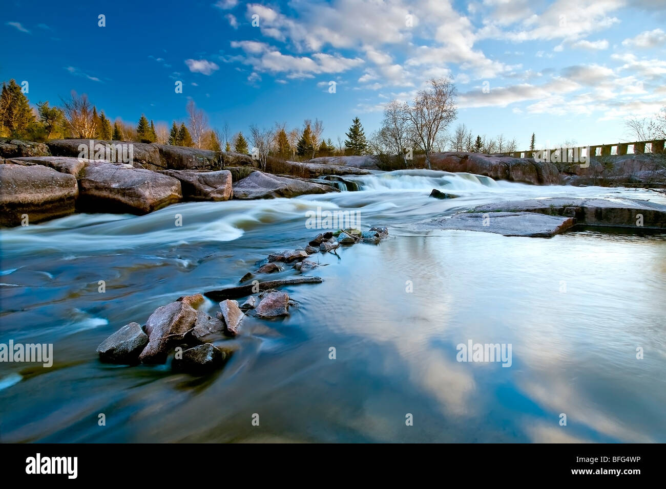 Water rapids on Winnipeg River site of Old Pinawa Dam. dam was Manitoba's first hydro electric dam but was closed - Stock Image