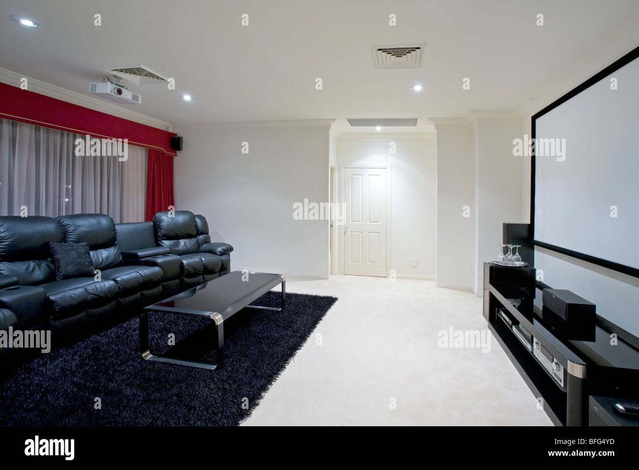 home theater room with black leather recliner chairs projector ...