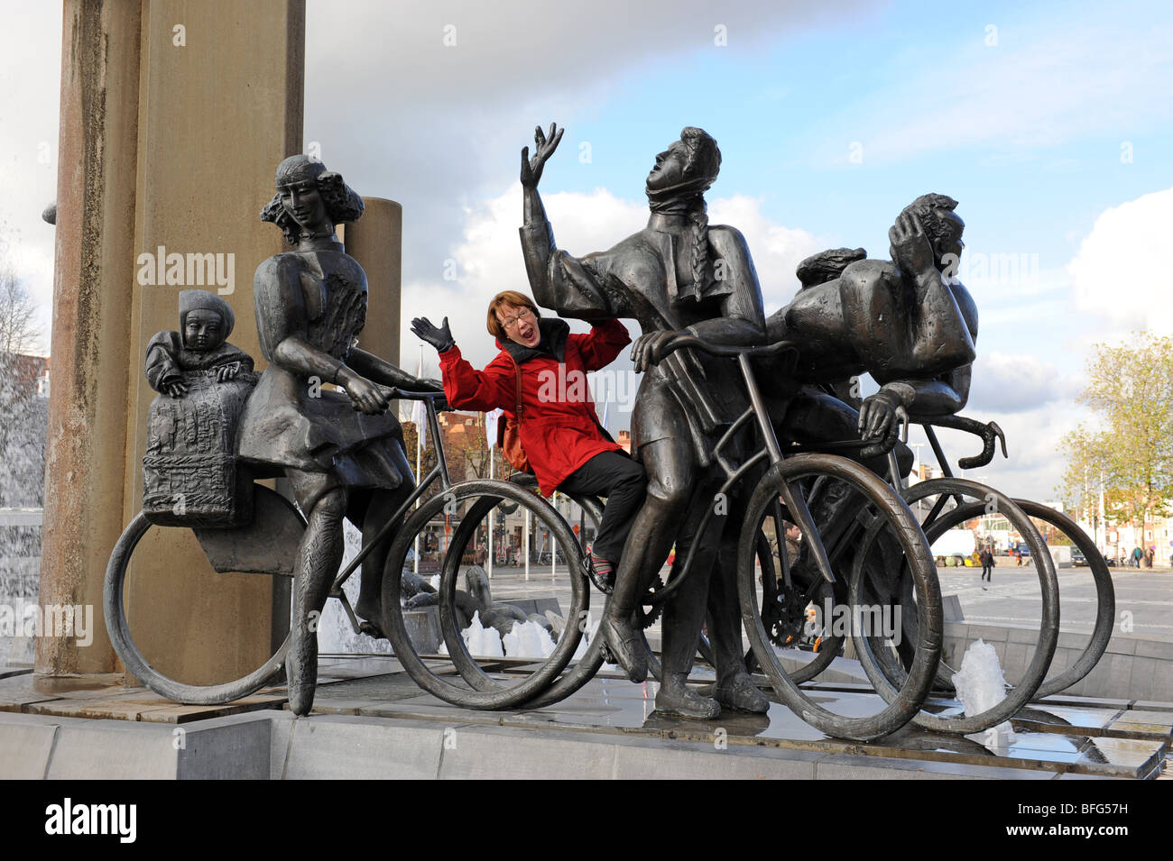 Woman tourist with Statues in The Zand square at Bruges in Belgium Europe - Stock Image