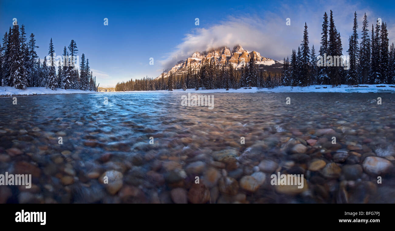 A panoramic view of Castle Mountain from within the Bow River in Banff National Park, Alberta, Canada - Stock Image