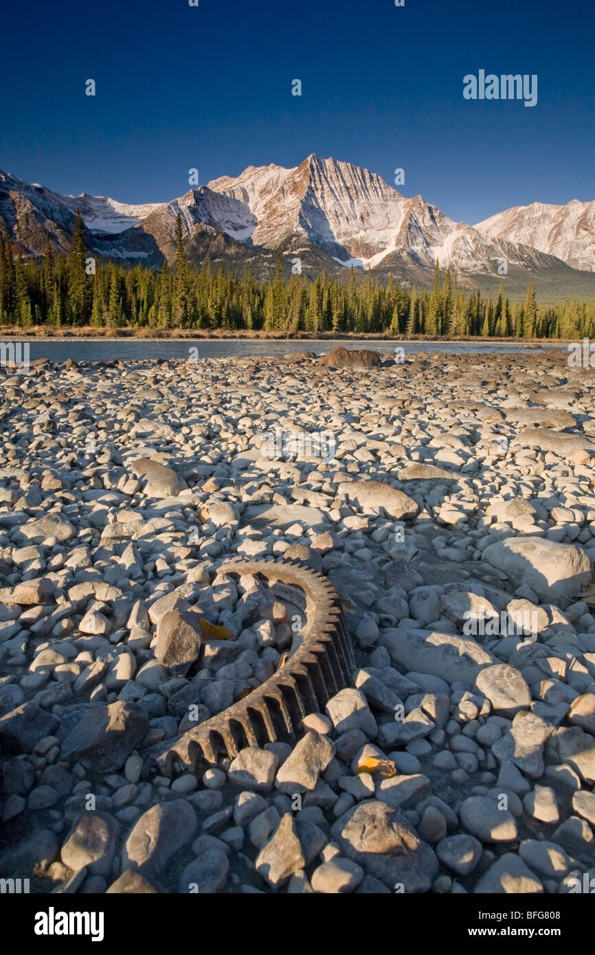 Trash left on the bank of the Athabasca River with Mount Fryatt in the distance, Jasper National Park, Alberta, Stock Photo