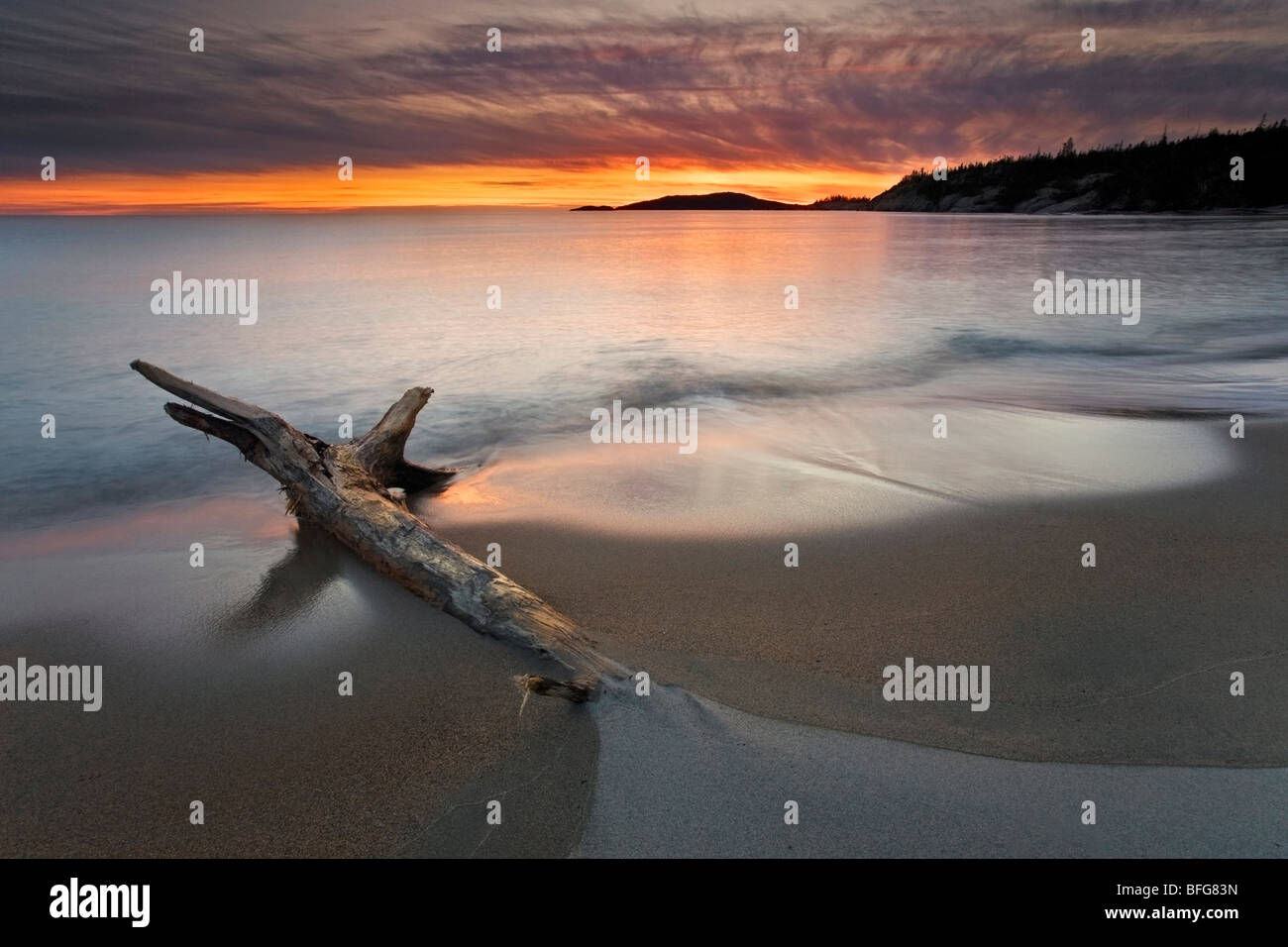 Sunset at Sandy Beach, on the shore of Lake Superior, Ontario, Canada - Stock Image