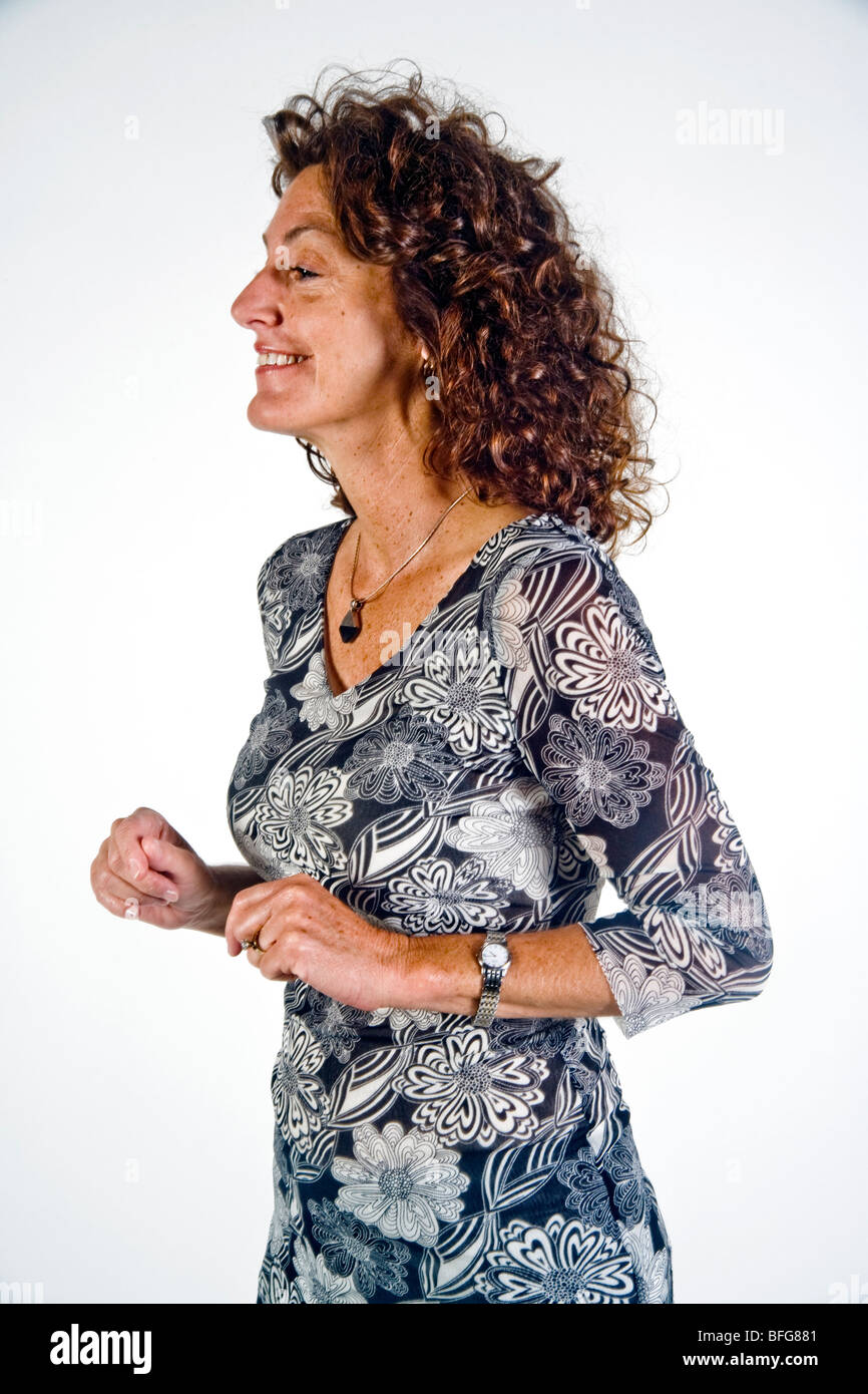 The posture of a tilted head indicates an interested mood in this woman in body language terms. - Stock Image