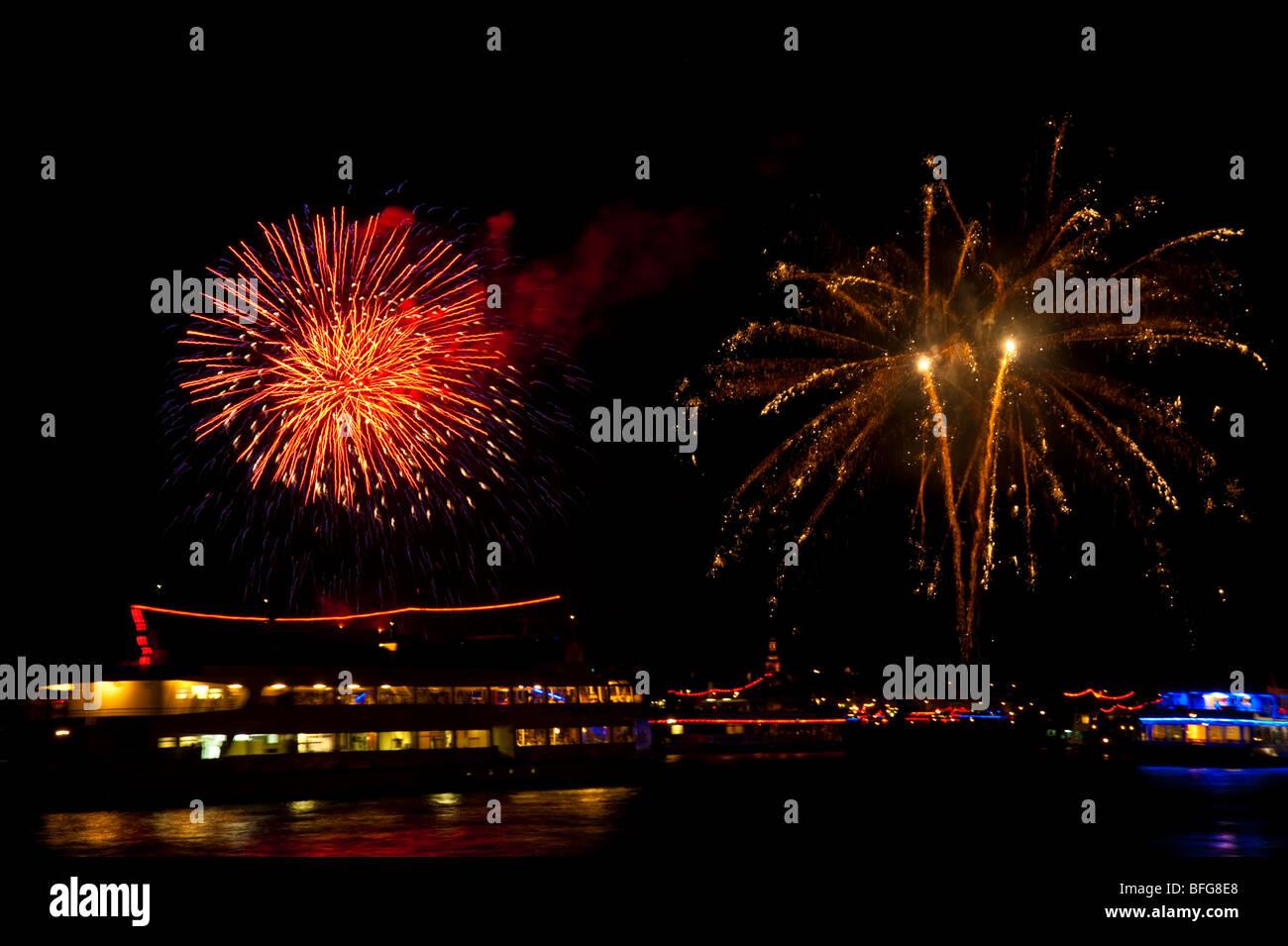 Cruise ships on Rhine river stopping for fireworks Rhein in Flammen near Bingen, Germany - Stock Image
