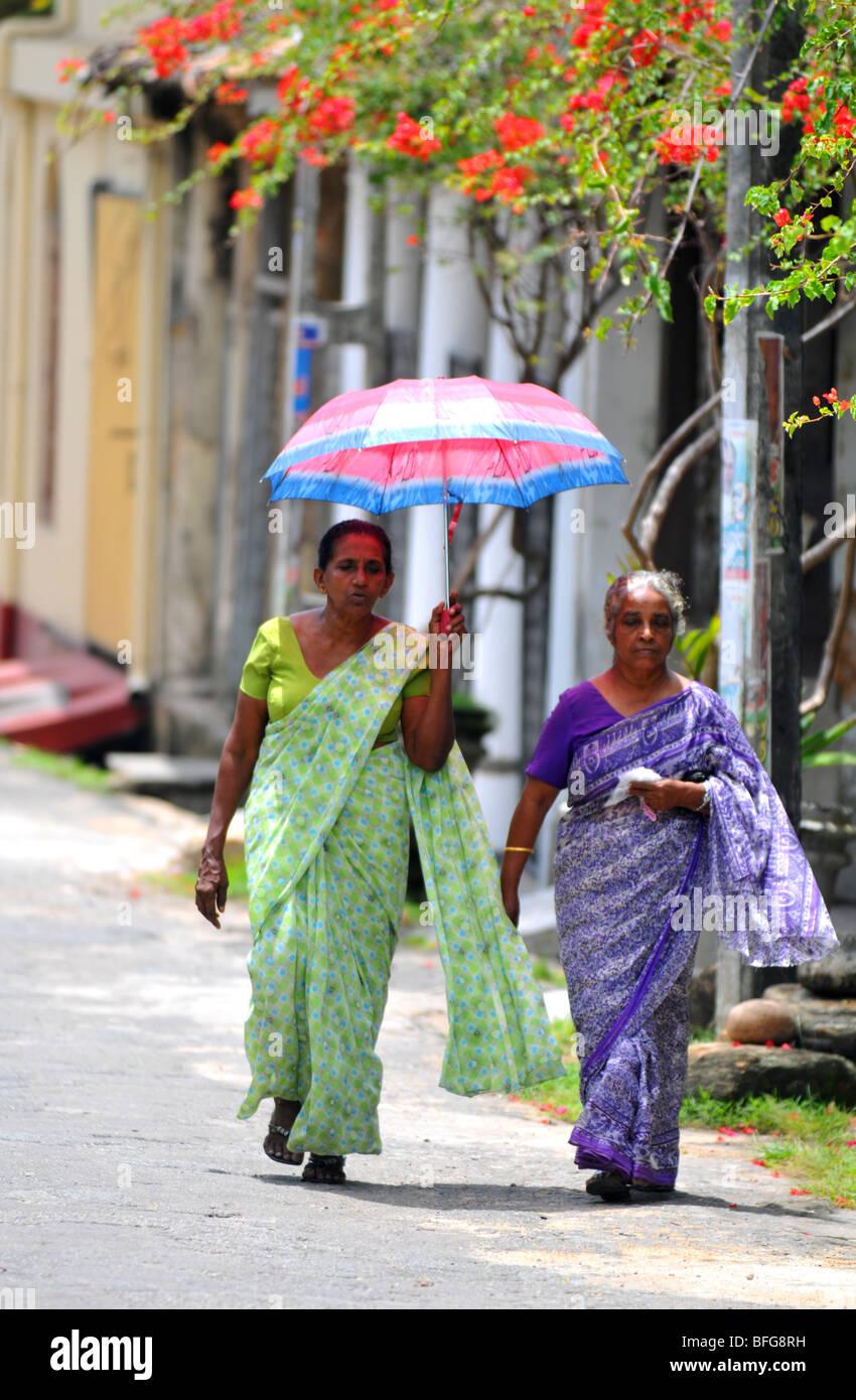 Sri Lanka Women Women Walking With Parasol Wearing Saris