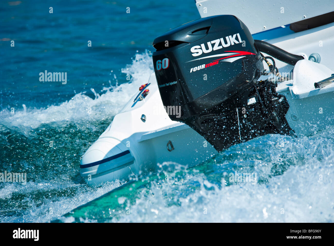 New 2009 model of Suzuki DF 60 outboard engine on power boat transom -  Stock Image