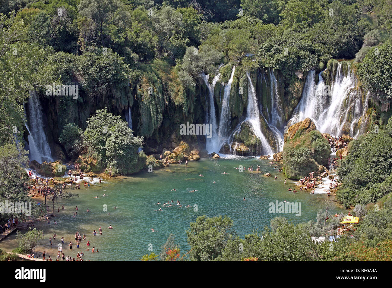 Bosnia and Herzegovina, Herzegovina Ljubuski district. Kravica Waterfalls on the Trebizat River with visiting tourists. Stock Photo