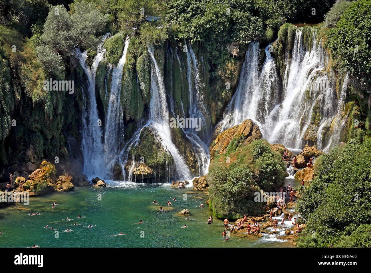Bosnia and Herzegovina, Herzegovina Ljubuski district. Kravica Waterfalls on the Trebizat River with visiting tourists. Stock Photo