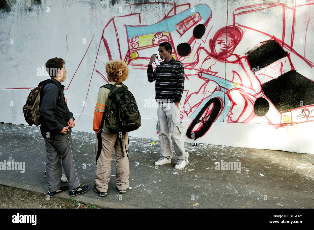 Paris, France, Street Scene, Young Male French Teen Street Graffer, Painting Wall, Talking to Younger Teens on Street, - Stock Image