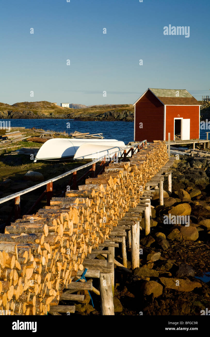 firewood stacked on stage, Change Islands, Newfoundland & Labrador, Canada - Stock Image