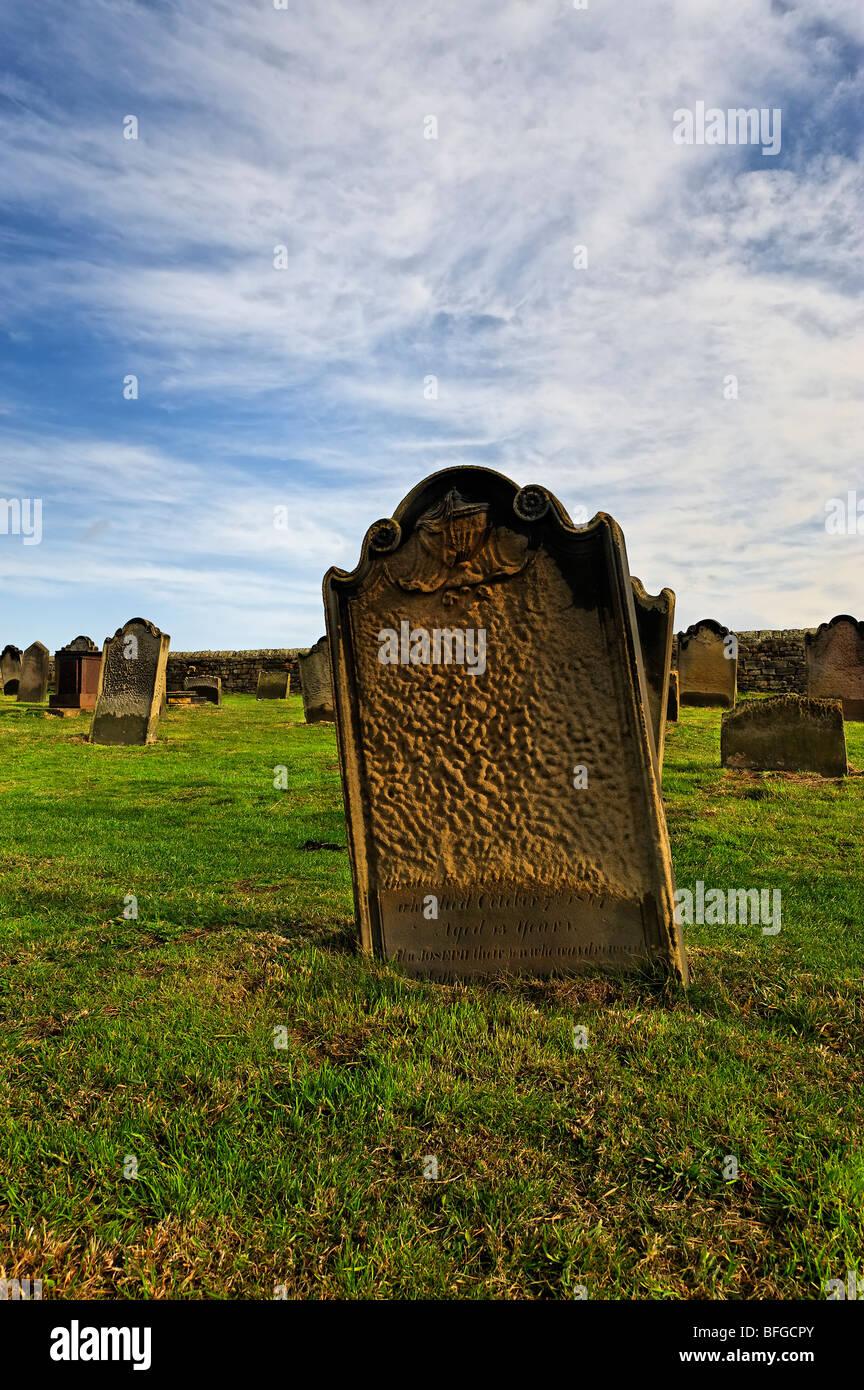 Weathered 19th century gravestones - Stock Image