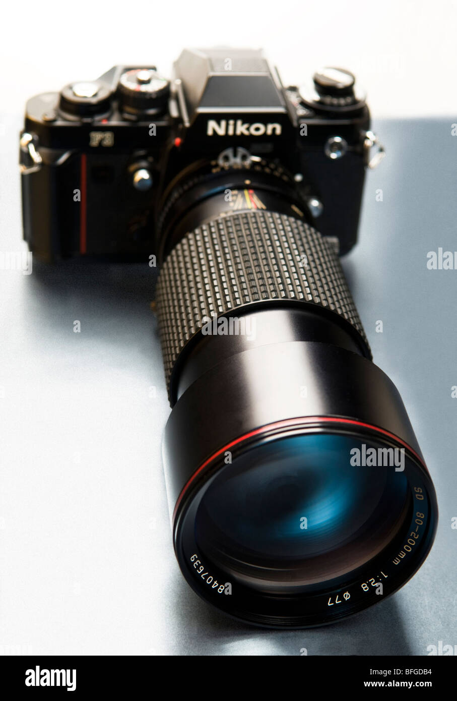 An artistic view of a Nikon F3 camera with a long lens attached. - Stock Image
