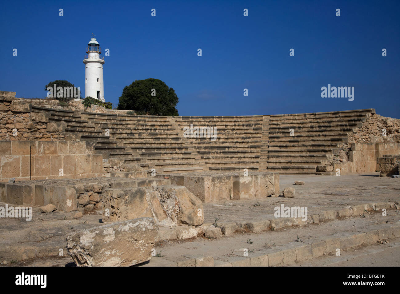 ancient roman odeon theatre with paphos lighthouse republic of cyprus europe Stock Photo