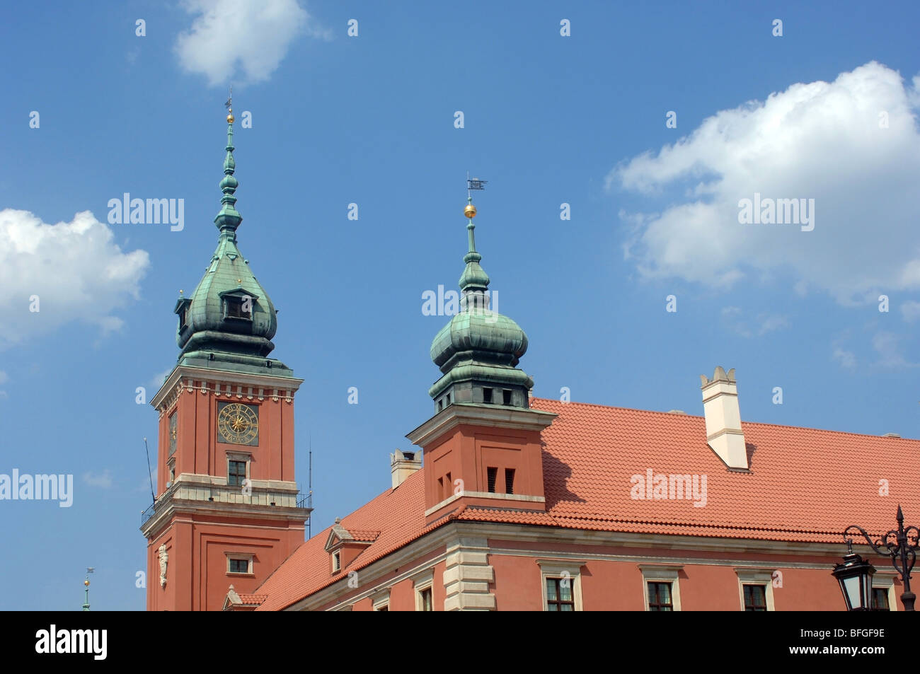 Upward view of the Royal Castle in Warsaw, Poland showing the architectural detail and a pleasant blue sky with Stock Photo