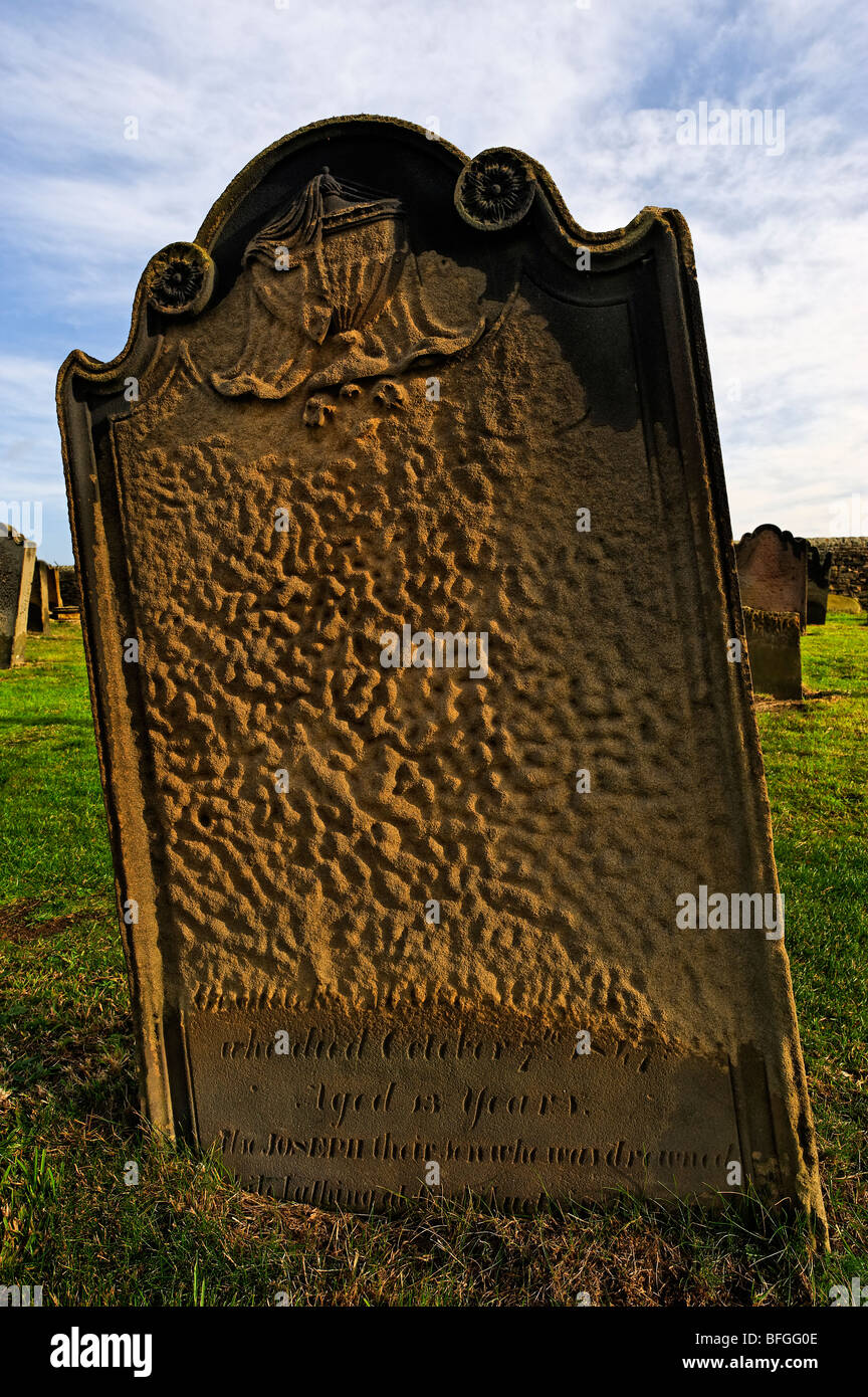 Weathered 19th century gravestone - Stock Image