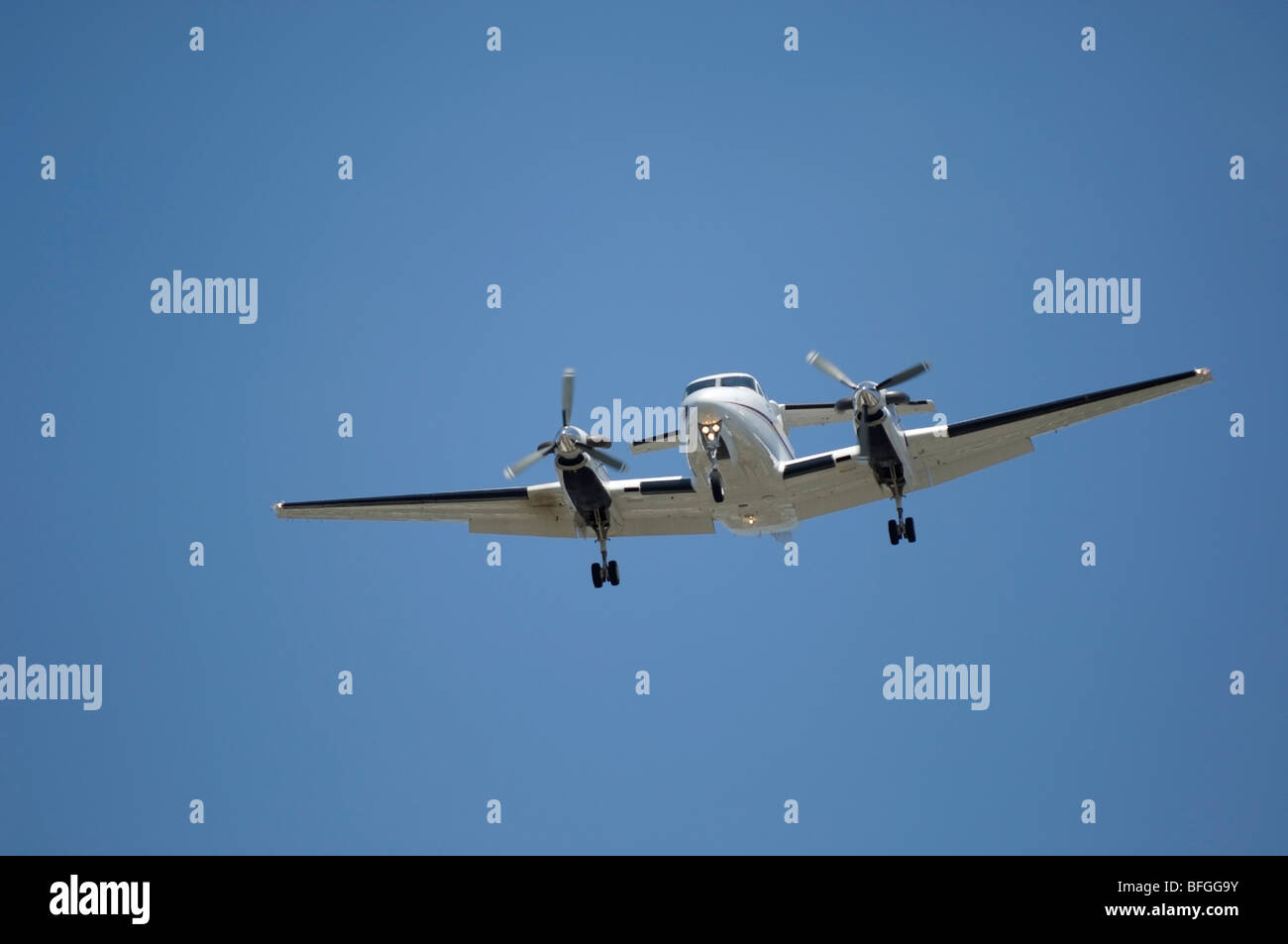 Twin Turboprop landing-  Beech Super King Air 350 Fixed wing multi engine (19 seats / 2 engines) Stock Photo