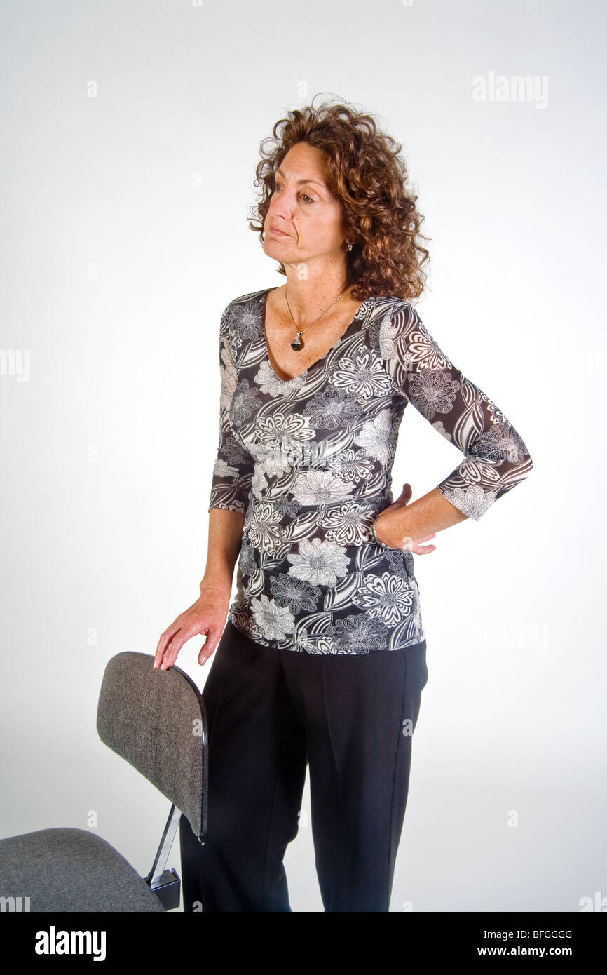 The gesture of tapping or drumming her fingers indicates impatience in this woman in body language terms. - Stock Image