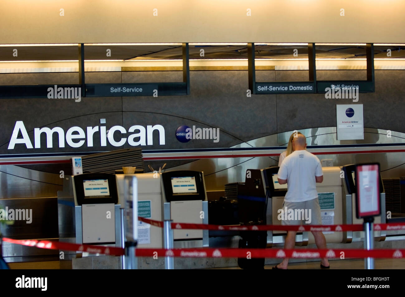 A Man Checks In For His Flight At The American Airlines