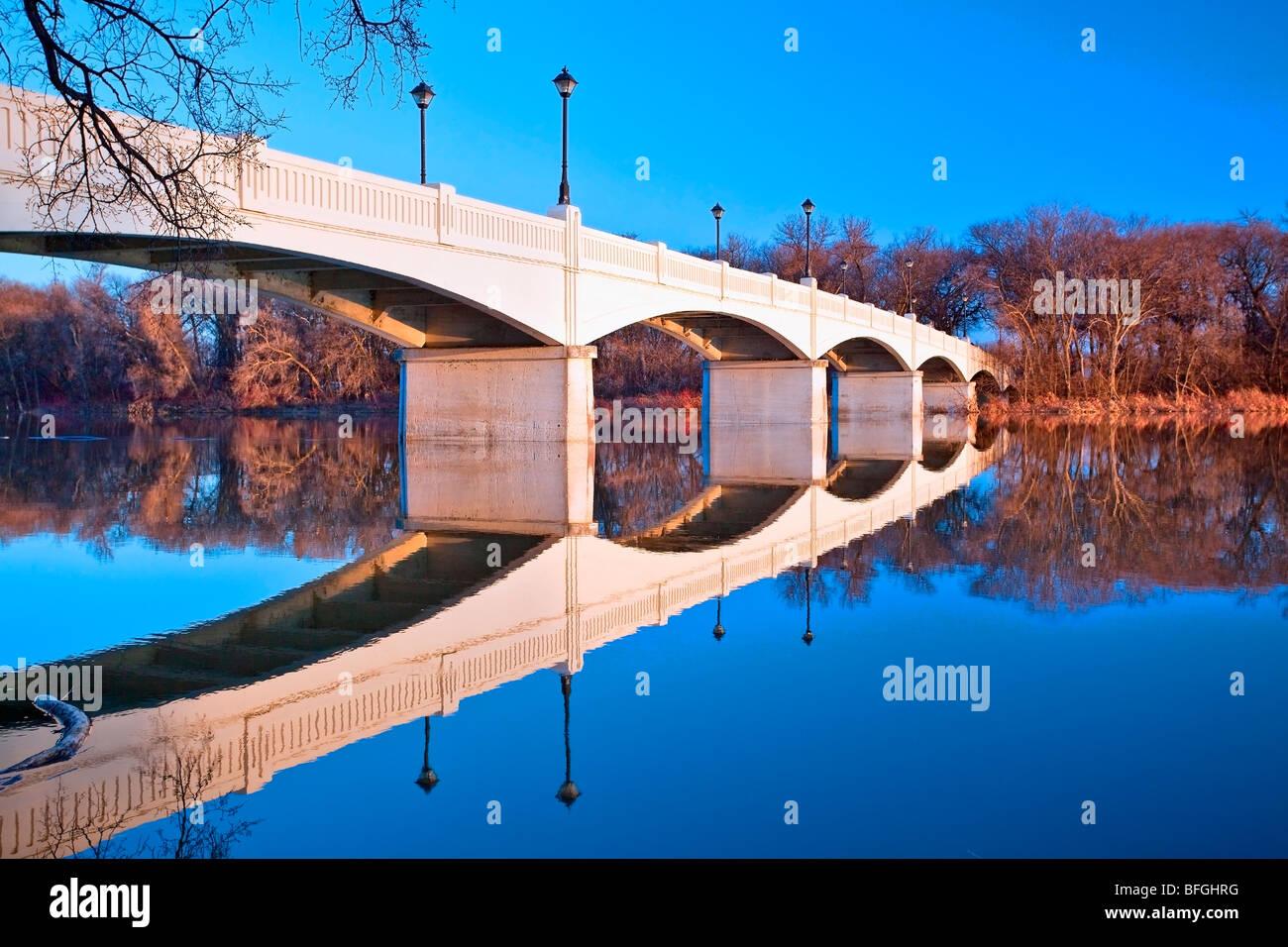 Assiniboine Park foot bridge crossing the Assiniboine River, Winnipeg, Manitoba, Canada - Stock Image