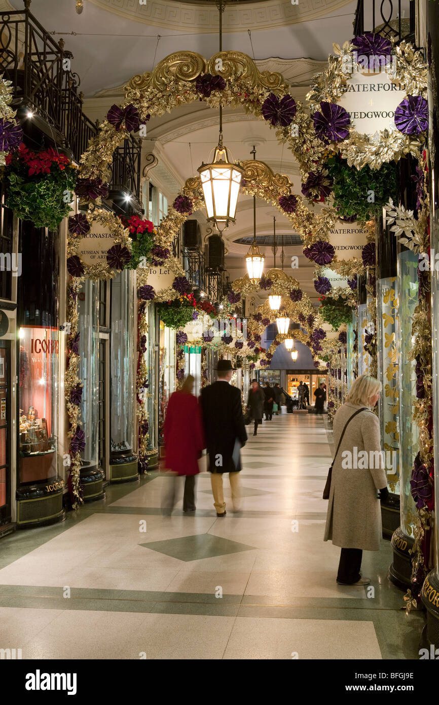 Christmas shopping in the Picadilly Arcade, off Picadilly. - Stock Image