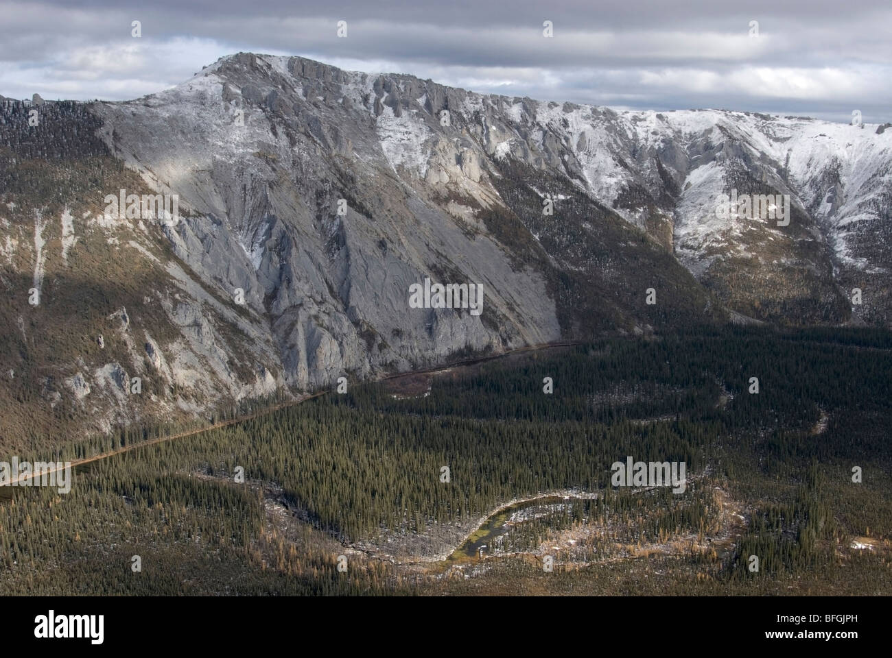 Aerial of Bear Cave Mountain and Fishing Branch River in northern Yukon Territory Canada in early winter. Mountain - Stock Image