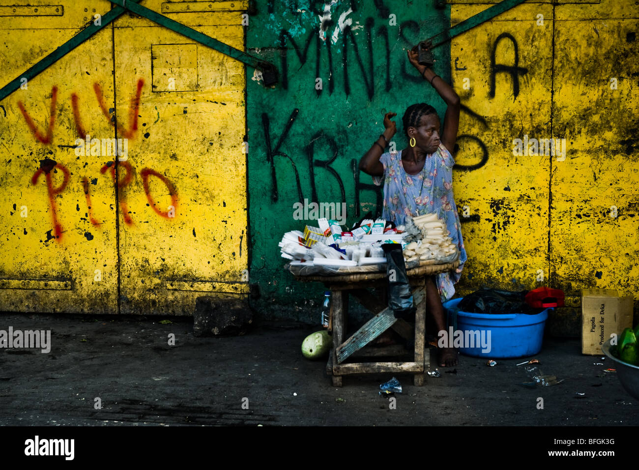 A woman reselling cigarettes and candies in the La Saline market ...