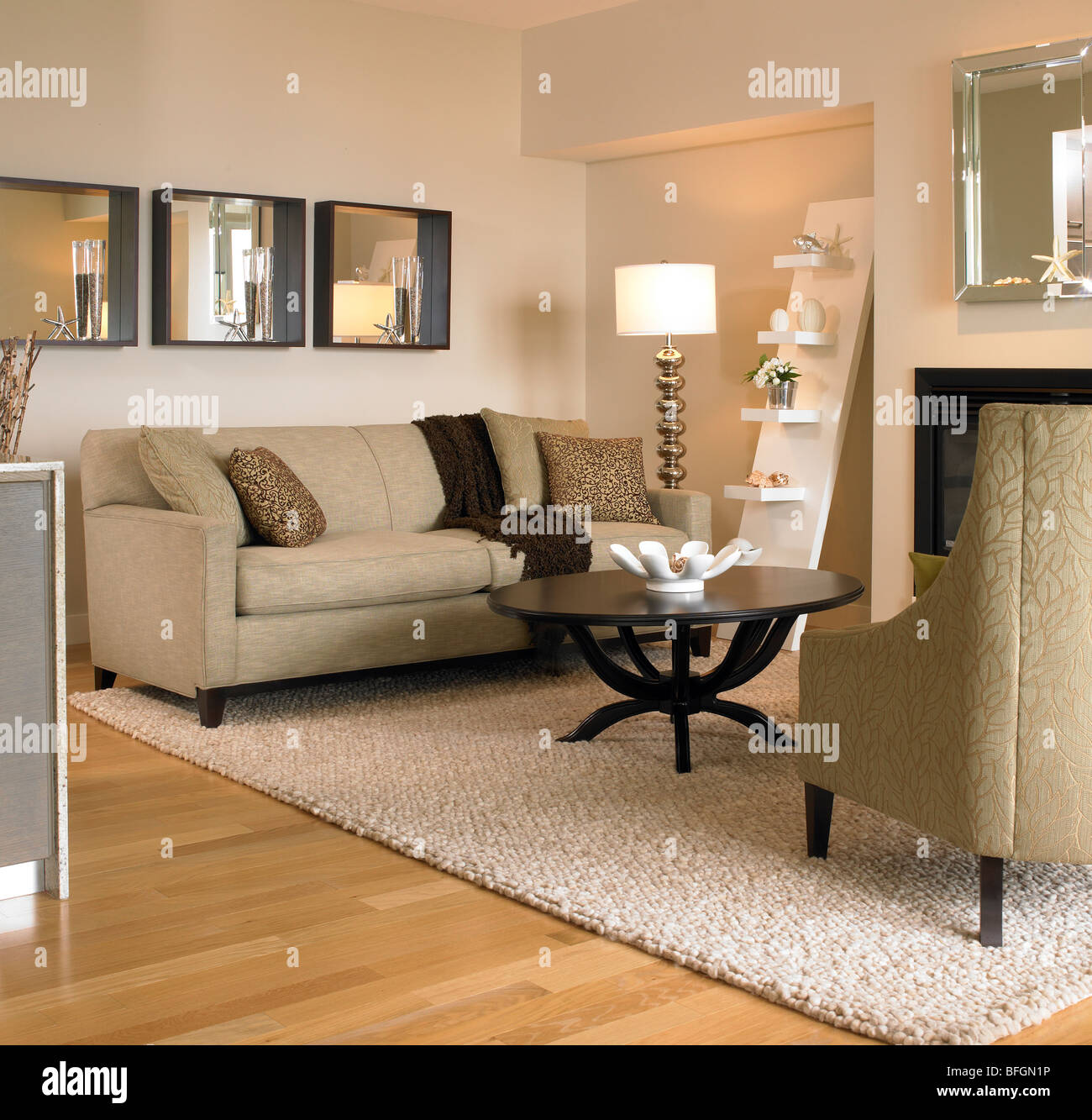Beige living room with black coffee table, Victoria, British Stock