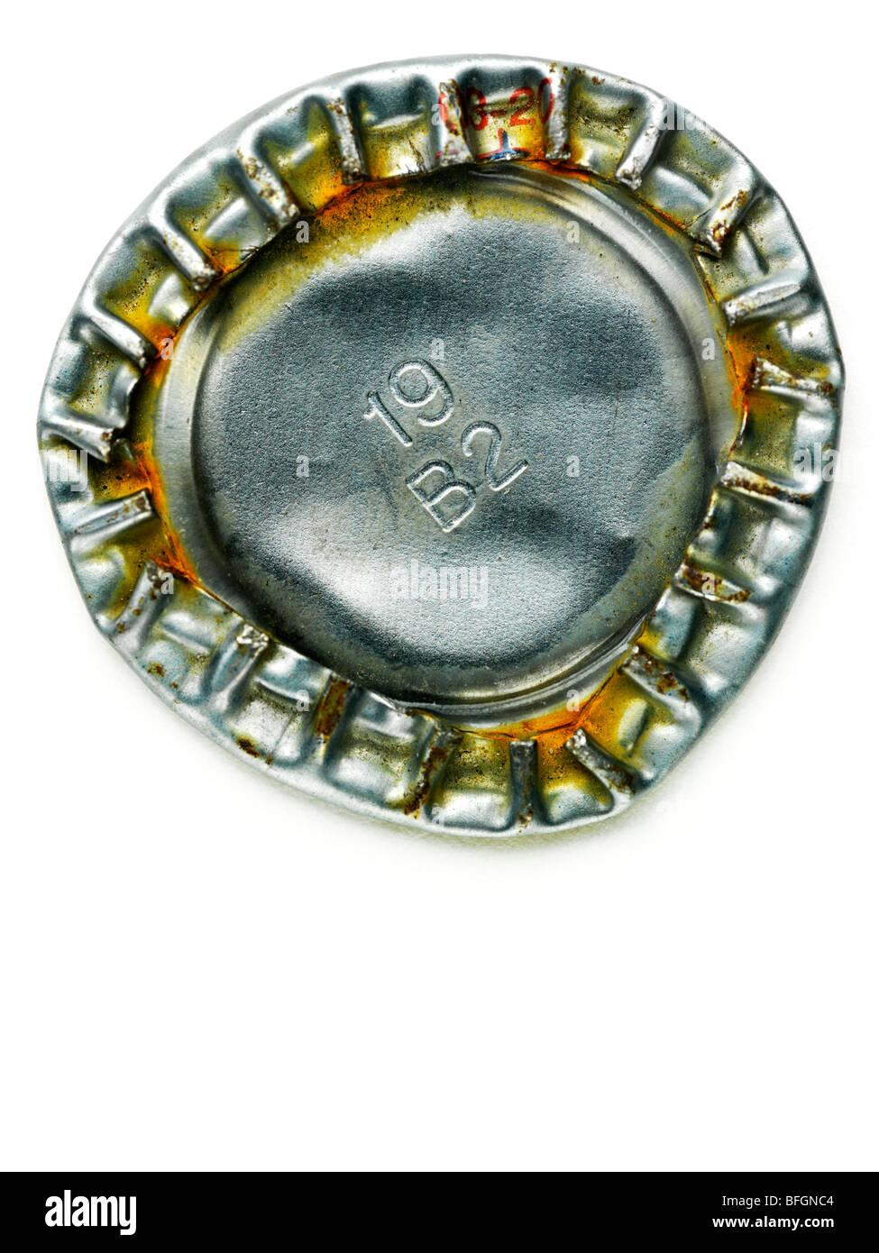 Close-up of underside of flattened beer cap - Stock Image