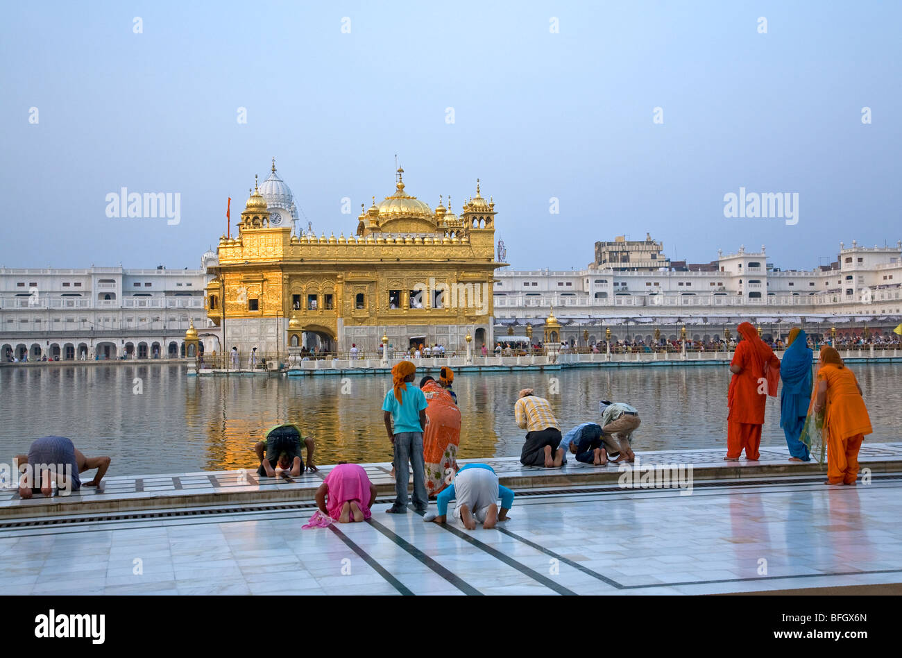 Sikhs Pilgrims Prostrating In Front Of The Golden Temple Amritsar