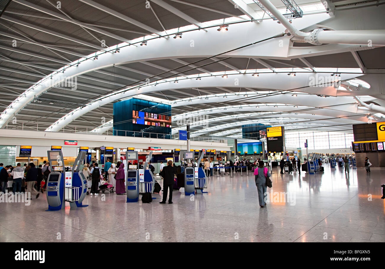 Departures concourse terminal 5 Heathrow international airport London England UK - Stock Image