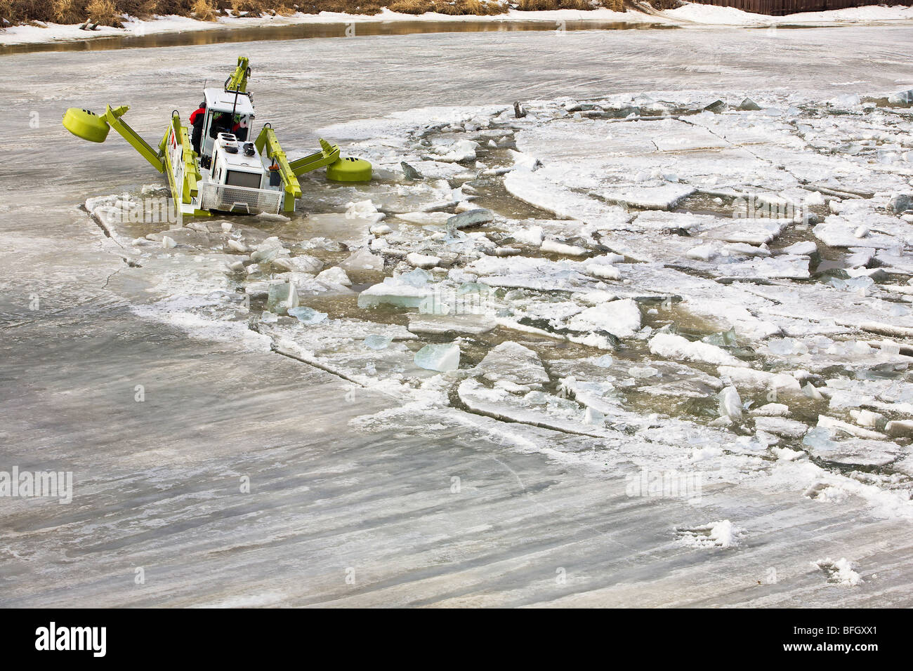 Amphibex machine breaking up ice on the Red River, during 2009 flood, near Selkirk, Manitoba, Canada.  Just north Stock Photo