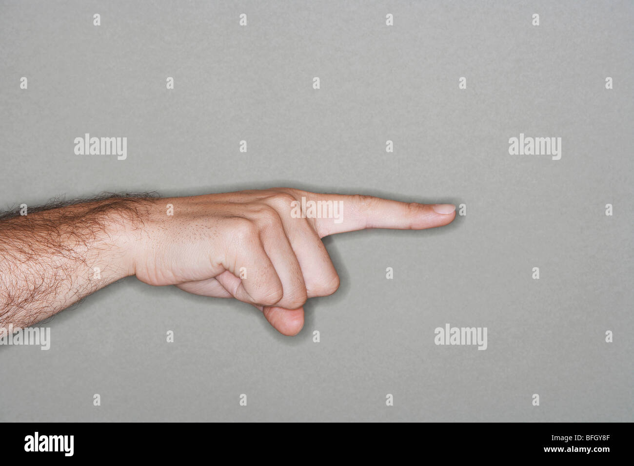 Man pointing with index finger, close-up of hand - Stock Image