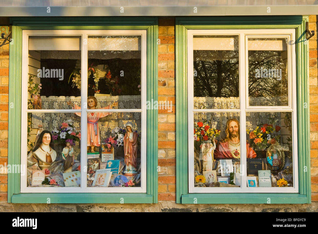 Window display of a shop that sells religious and devotional objects, Quebec City, Quebec, Canada - Stock Image