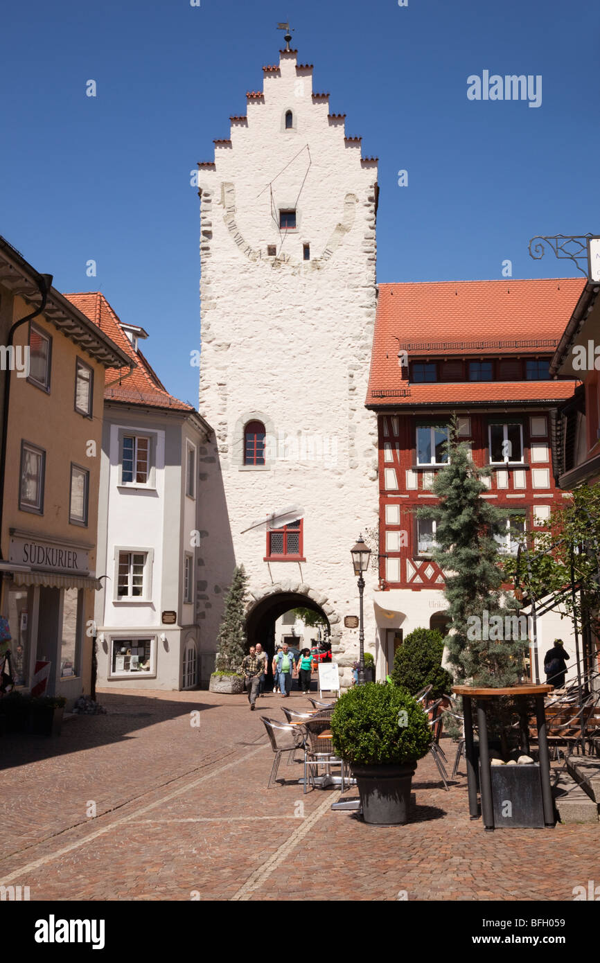 Marktstrasse, Markdorf, Baden-Wurttemberg, Germany. Old gateway and large sundial on cobbled street within Altstadt - Stock Image
