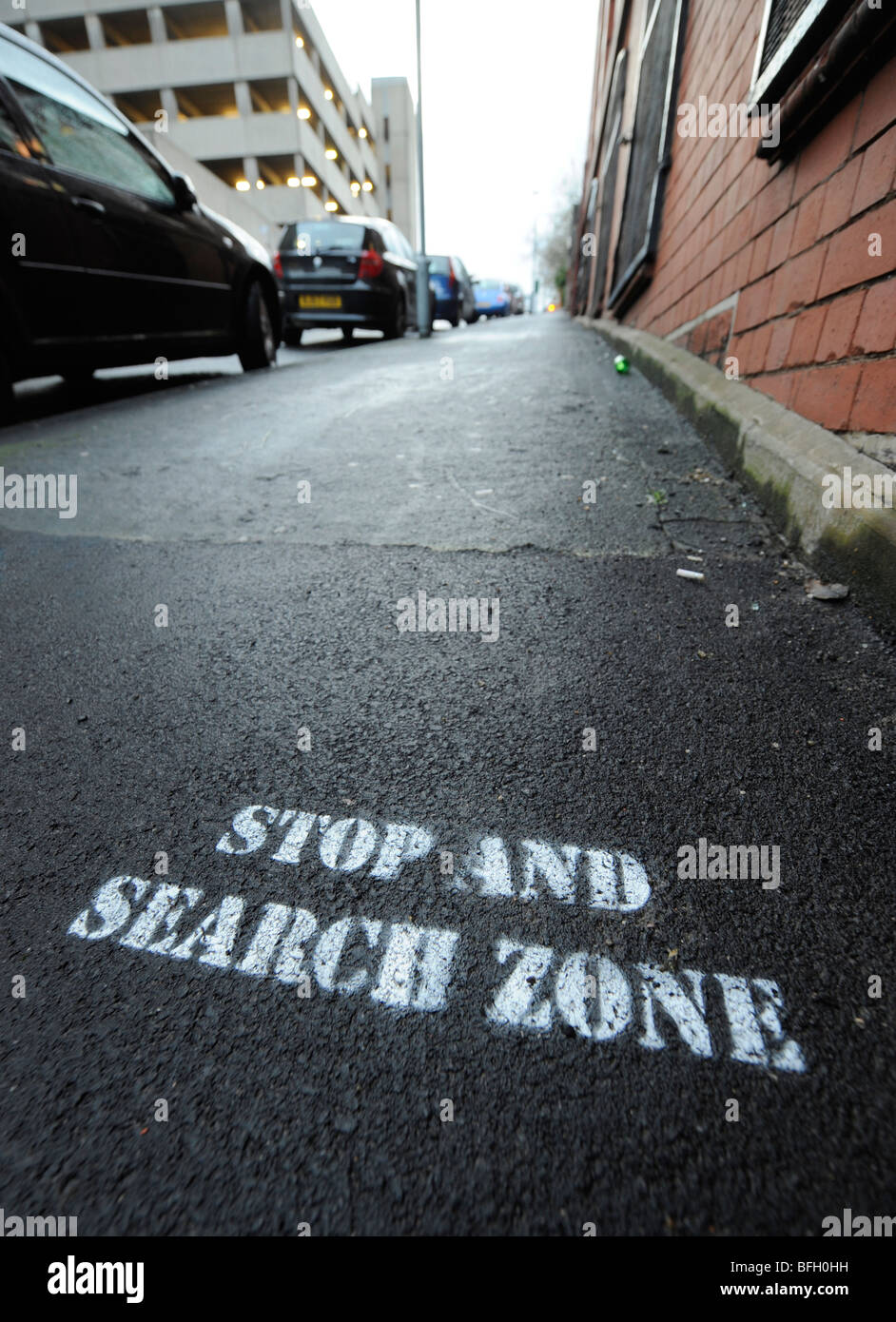 STOP AND SEARCH ZONE SIGN ON A STREET PAVEMENT IN BIRMINGHAM UK. - Stock Image