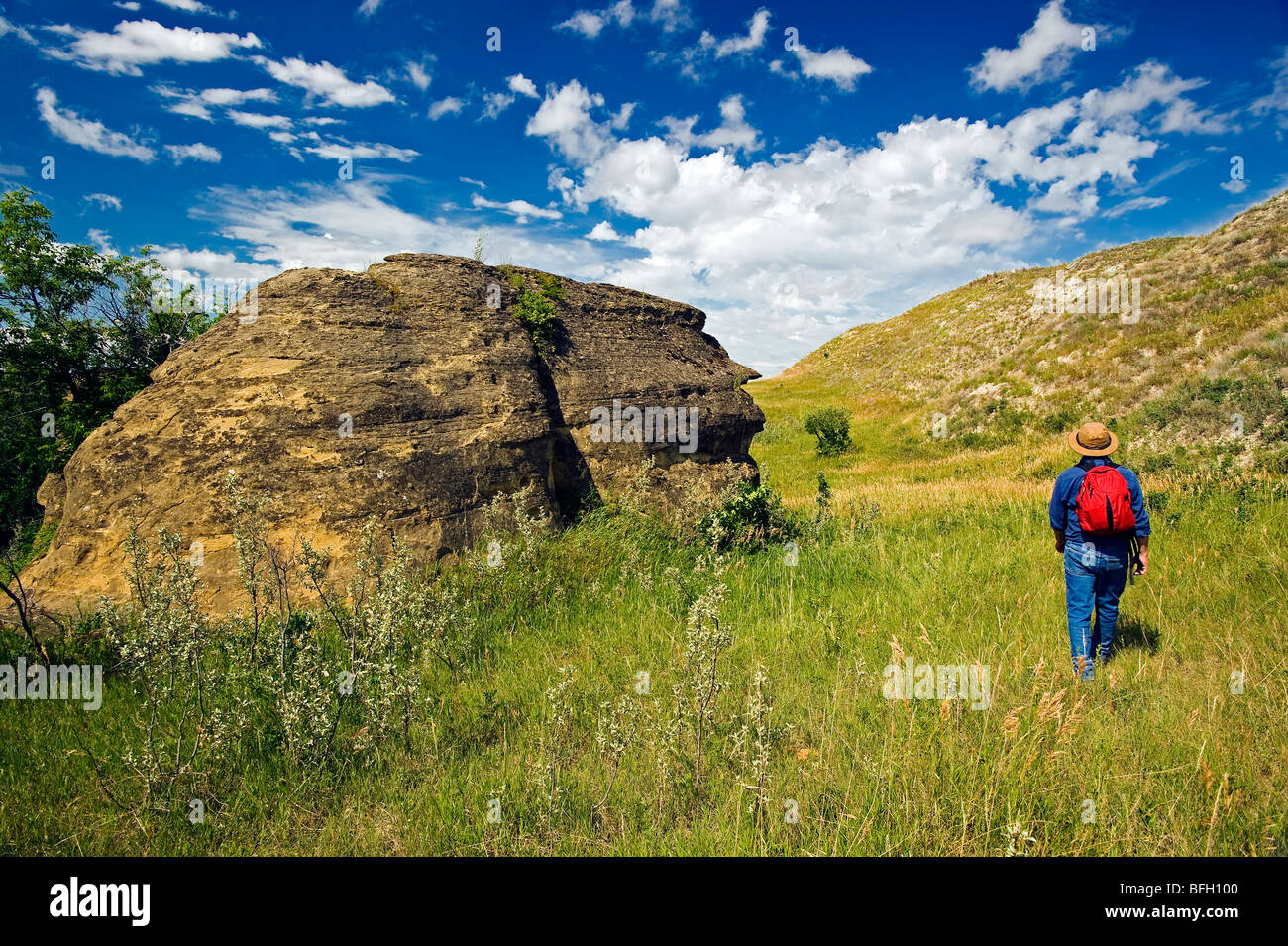 hiker, rock formations near Roche Percee, Souris River Valley, Saskatchewan, Canada - Stock Image