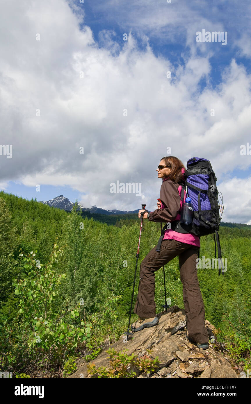 A woman enjoys the tremendous scenery on a beautiful day near Valemount, Thompson Okanagan region, British Columbia, Stock Photo