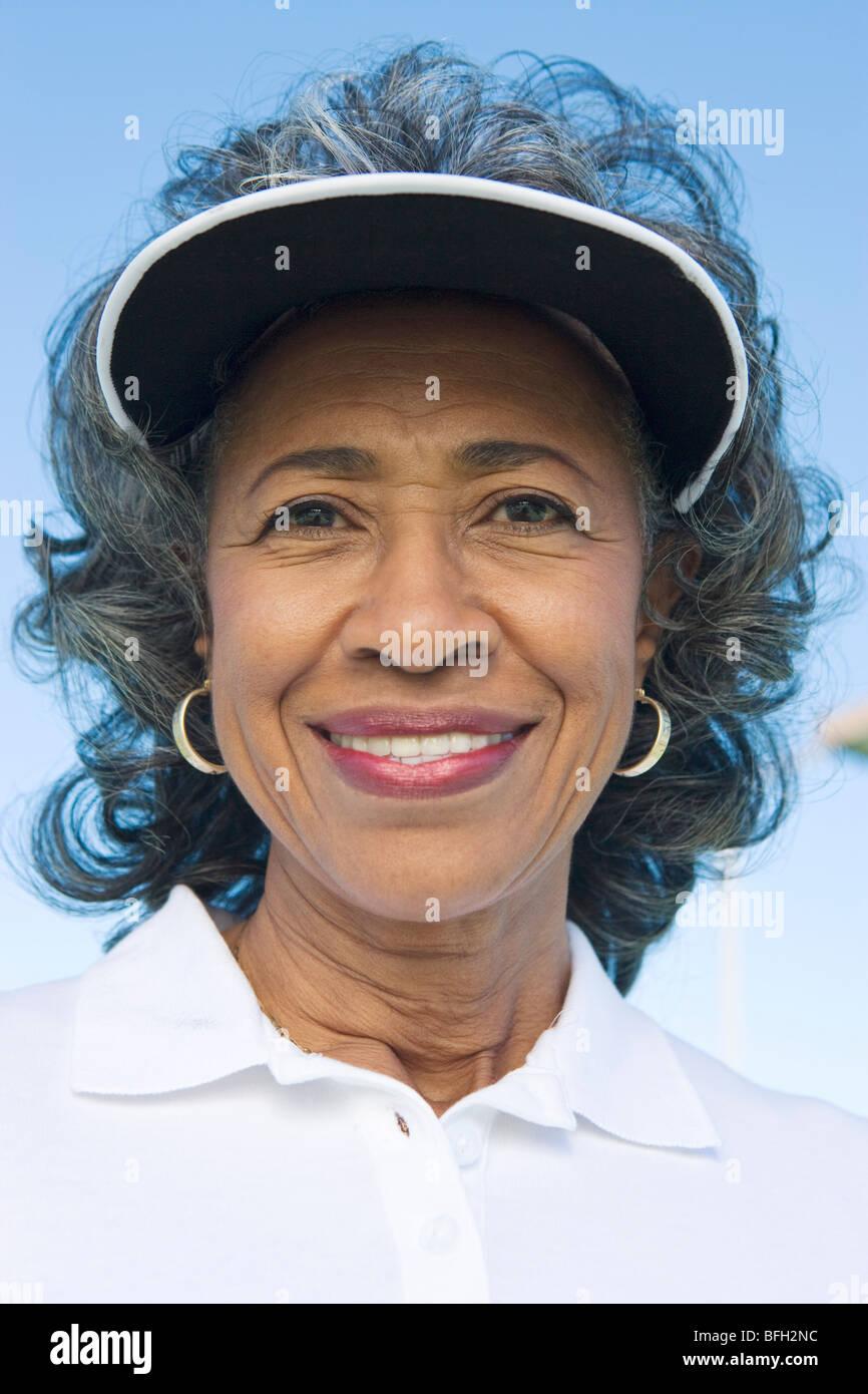 47a3011b Woman wearing sun visor, portrait Stock Photo: 26805560 - Alamy