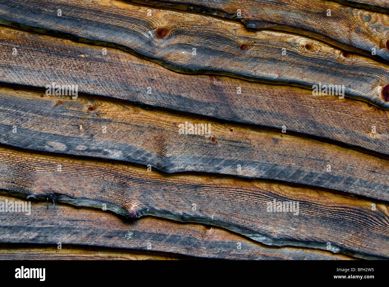 Antique slab lumber siding on old barn in western North Carolina, USA - Stock Image